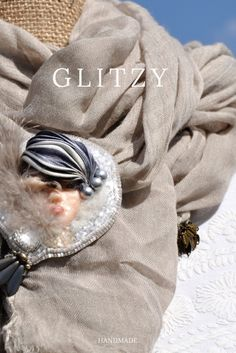 Yes!.... I want one . The Hunter handmade GLITZY Brooch cabochon made with polymeric clay hand paint by Maria Romano,the same surrounded by a glittering circle of delicate white, changing silk and natural feathers.Original and elegant to wear only 17 gr weight , wittily on sweaters, colored coats, hats, scarves or simply blouse in silk, this is a very special way to make your unique and valuable garment.