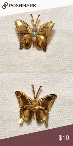 Vintage Filigree & Pearl Butterfly Brooch Vintage filigree & pearl butterfly brooch is gold toned. The butterfly body has pearls. Excellent condition. Jewelry Brooches