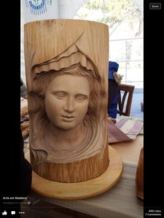 Carving face 3d on wood