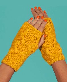 Free Knitting Pattern for Flat Knit Cable Wristwarmers - These easy Snowfall fingerless mitts are knit flat with cable and seed stitch and seamed. Designed by Paintbox Yarns