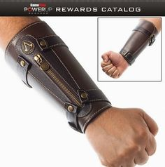 Wear the mark of the Assassin with pride and pick up the Assassin's Creed IV Wrist Cuff!