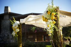 Yellow and white flowers on Chuppah