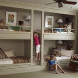 We've always loved bunk beds for how they combine function with fun, but built-ins have the potential to be even more functional and more fun than your average bunk. They're a great option for vacation homes, since even after kids grow up, a vacation house is likely to need sleeping space for lots of guests. So as Escapes Month winds to a close, here are a few built-in bunk beds we love and some thoughts about why they work so well...