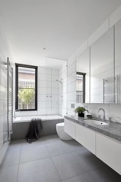 House in Melbourne by Tom Robertson Architects « white and grey modern bathroom, floating vanity, face storage behind mirrors Grey Modern Bathrooms, Gray And White Bathroom, White Vanity Bathroom, Large Bathrooms, Modern Bathroom Design, Bathroom Interior, Bathroom Vanities, Bathroom Ideas, White Bathrooms