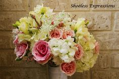 white, pink, and yellow flowered bouquet