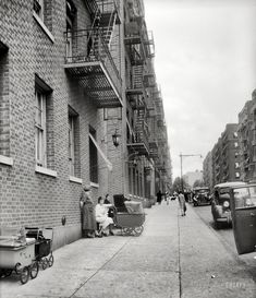 """June 1936. """"Bronx, New York. Background photo for Hightstown project. Many of the future Hightstown settlers are now living in the Bronx district. This is the street on which Mr. Morris Back and family, certified applicant for resettlement, now live."""" Photo by Dorothea Lange for the Resettlement Administration, whose plan to move hundreds of Eastern European, mostly Jewish, immigrants from New York to rural New Jersey met with a resounding """"meh."""""""