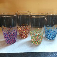 Acrylic paint dots on glasses, then put in cold oven, heat to 350, leave in for 30 minutes, turn over off and let cool.