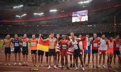 World Athletics Championships 2015: day eight – in pictures   Sport   Eaton, front centre, celebrates with bronze medallist Rico Freimuth, front left, and silver medallist Damian Warner, front right, and the rest of the decathlon athletes after finishing their 10 events