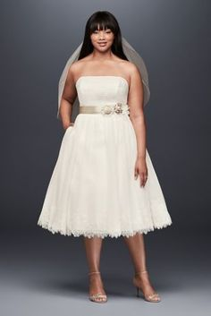 Perfect for simple weddings or pre-wedding events, this dotted tulle extra length plus size dress has the lacy bodice and hem detail of a formal gown with the ease of a short silhouette.   Galina, exclusively at David's Bridal  Polyester  Back zipper; fully lined  Dry clean  Imported  Also available in regular as Style 9WG3858