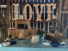 Light blue antique table small crates wood stump cupcake stand(photo by Cake Bakery)