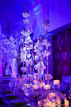Whimsical orchid and silver sphere centerpiece from Melissa and Dean's reception. Wedding and design by Tiffany Cook Events
