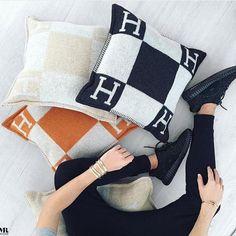 three beautiful HERMÈS Pillows.