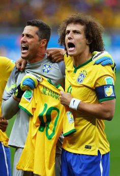 Brazilian Players Hold Neymar's Jersey During During The Anthem Before The Brazil-Germany Game
