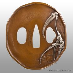 15-04-13 Utsushi of a tsuba by Mitsuoki Otsuki, spring grasses theme. Made for the 6th NBSK Tobunkyo Competition (May-Aug 2015, Japan). Awarded silver. Shinchu base, shibuichi grass and fine silver snow. 70mm x 79mm x 3.75mm. Private collection (CL), Canada.