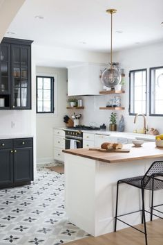 Love the mix of modern, traditional and globally-inspired styles in this monochromatic kitchen.