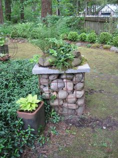 Stone-filled gabion w/rock garden on top! {many more delightful pics on this site}