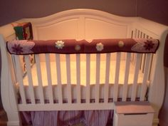Bumper Pad UPCYCLE... My baby's bumper pad converted into a teething guard for her crib rail. Easy to tie on and take off to wash.