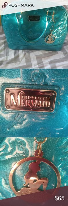 Oh mermaid bowling ball style handbag It's absolutely beautiful LIKE new Little Mermaid bowling ball handbag was purchased at the Walt Disney World Resort! A jade green green Sparkle detail mermaid etching in Design! Absolutely no markings excellent condition perfect for The Little Mermaid collector! 🐚 please absolutely no low-ball offers I do lover listing call First make a bundle I will give you an offer with discount shipping. All items owned by me my daughter sister family & friends🏰…