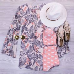 Add some magic to your pool-wear with this beautiful print dress for your cover-up! This dress is now online! www.shopelysian.com  Tropical In Peach Shift Dress $52. online  in-store. Lena Stone Pendant Necklace $28. in-store only. Quay The In Crowd Sunnies $48. in-store only. Morning Stroll Hat $32. in-store only. Pretty in Pink Swan Swim Top $54. online  in-store.  Pretty in Pink Swan Swim Bottoms $34. online  in-store only. Bed Stu La Cruces Flat $190. online  in-store.  #WearElysianDaily…