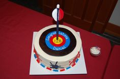 For an Eagle Court of Honor reception.  The eagle scout loves archery and graphic design.  The ink splats on the side of the cake match his invitations.