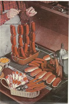 There is no definition, no words to describe just how classy it is to hang hot dogs from a wire hanger. Add to it the silverware that looks like it has little hot dogs for handles. It would suck to be the guy with the apron if that hanger buckled under the weight of the wieners. (Better Homes and Gardens Barbecue Book, 1965)