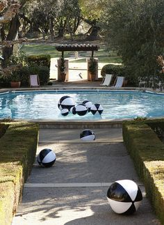 pool party with black and white beach balls and retro synchronized swimmers