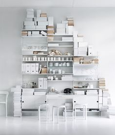 The white and neutral colored storage boxes make a small space look larger and less cluttered.