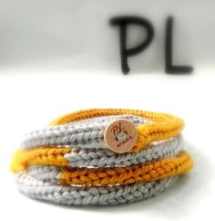 Knitted color block gray and yellow skinny infinity rope by PLwear, $18.00