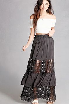 A woven maxi skirt featuring an elasticized waist, tasseled self-tie, sheer crochet panels, and a ruffle layer. This is an independent brand and not a Forever 21 branded item.
