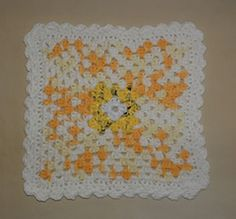 "I love handmade dishcloths and even better are ones that have center scrubbers. Just in time for the big Summer holiday, here is my latest ""Sunshine"" dishcloth I crocheted with a center scrubbie made from recycled plastic bags"
