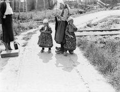 Willem van de Poll photo -- woman knits whiletalking & walking with children, Netherlands, date unknown
