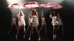 Victoria's Secret Angels & Umbrellas. This latest video from Victoria's Secret features Candice Swanepoel, Elsa Hosk and Jasmine Tookes showing off their best dance moves while twirling around umbrellas from the retailer. The film was made to share a new promotion where when shoppers buy two bras, they can get an umbrella for free. Wearing white bra and panty sets with see-through raincoats, the girls turn up the heat in the flashy video.