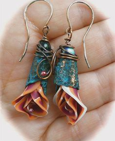 Flower bud earrings from polymer clay. Could these be done in sculpted fabric?