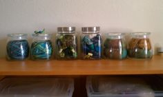 Pretty storage for yarn - making it decor as well! The side jars are from Amazon - http://amzn.to/PGDXc9 - the center ones I purchased at Homegoods.