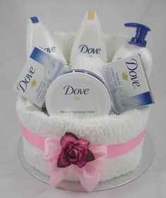 Amazing towel cakes perfect for Mother's Day Dove Body Lotion, Shower Foam, Body Wash and Beauty bars Made to order Mothers Day Baskets, Mother's Day Gift Baskets, Themed Gift Baskets, Gift Hampers, Raffle Baskets, Easy Gifts, Creative Gifts, Homemade Gifts, Pamper Cake