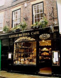 This adorable shop is in Whitby. IT is all decked out for Easter. Witch Store, Small Coffee Shop, Breakfast Cafe, Small Cafe Design, Tea Cafe, Cafe Interior Design, Uk Homes, Logo Restaurant, Bakery Cafe