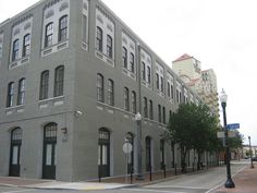 """700 Commerce Street - Around 1902, builders began using more advanced construction methods. The construction of this building spans the change from the French-Creole tradition and the """"decorate brick"""" style of many of the buildings in the Warehouse District. At the beginning of its time, this building was a sugar refinery named the Pelican Sugar Warehouse owned by the Henderson Sugar Refinery. Eventually the operation expanded into nearby buildings and this property was sold... more on…"""