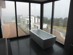 Have a bath with a view. And don't worry about the neighbours, it's privacy glass! (scheduled via http://www.tailwindapp.com?utm_source=pinterest&utm_medium=twpin)