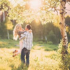Couples twirling in the sun golden hour engagements Portraits by Andra