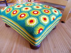 hexagon granny covered stool - could be awesome with the blanket I'm about to finish!