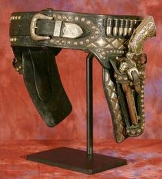 Edward H. Bohlin Silver Gun Rig with Revolvers - March in Montana Cowboy Holsters, Western Holsters, Gun Holster, Leather Holster, Leather Tooling, Weapons Guns, Guns And Ammo, Airsoft, Colt Single Action Army