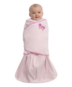 Replacing traditional loose blankets with a safeguarded zip-up silhouette and adjustable swaddle wrap, this darling HALO SleepSack Swaddle fits over pajamas to provide ventilation and warmth. Its roomy design allows for lower body movement, and an inverted zipper simplifies diaper duty.