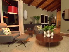 love: mid century chairs, exposed beams and red lamp