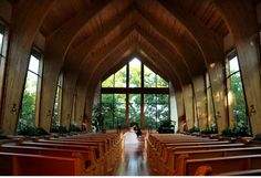 Harmony Chapel in Aubrey / the glass walled wedding chapel is gorgeous / the turned wood ceiling is over three stories tall! / receptions are held in the reception hall with large windows overlooking the courtyard / Dallas wedding chapels