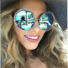 Decidedly glamorous and with a distinctive retro attitude, these wire sunglasses encapsulate a light, feminine and fluid mood, with a nod to vintage styling. Dramatically round and oversized metal fra Oversized Sunglasses, Mirrored Sunglasses, Sunglasses Women, Coachella, Divas, Halo, Transparent Sunglasses, Girls Rules, Fashion Deals