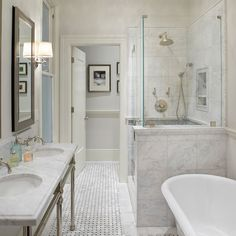 Anyon Interior Design - Gorgeous master bathroom with marble basketweave tiles floor, claw foot tub, Waterworks Universal Metal Round Three Leg Double Washstand, inset medicine cabinets, Restoration Hardware Lugarno Single Sconce and seamless glass shower with marble tiles shower surround with Greek key inset tiles.