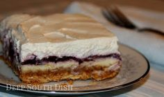 Blueberry pie ~ layered dessert made with graham cracker crust, cream cheese filling and topped with whip cream.