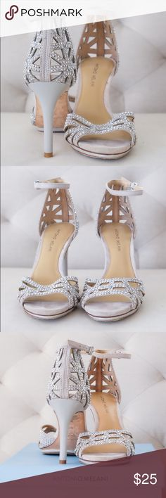 Antonio Melani Macall Gray Jeweled Heels Gray jeweled ankle-strap sandals/heels. I wore these shoes for most of my wedding day and into the reception. They are exceptionally comfortable with a decent amount of padding. I almost bought high-end designer shoes for my wedding until I tried these on and couldn't believe how comfy they were, and they looked beautiful!! Some wear on the bottom and slight toe imprints on the front inside. ANTONIO MELANI Shoes Heels