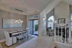 Transitional Great Room with Nate Berkus Cream and Metallic Diamond Area Rug, Gas Fireplace with Glass Doors, Pendant Light
