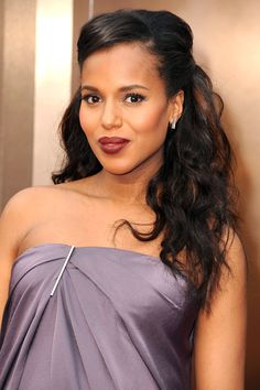 Kerry Washington's mane is pinned away from her face showcasing long, luscious locks and a flattering side part framing her gorgeous mug!